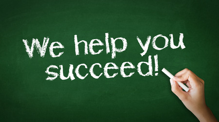 A person drawing and pointing at a We help you succeed Chalk Illustration