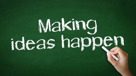 A person drawing and pointing at a Making Ideas Happen Chalk Illustration