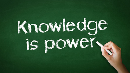 A person drawing and pointing at a Knowledge Empowers You Chalk Illustration Standard-Bild