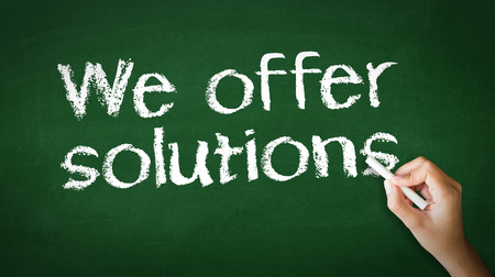 A person drawing and pointing at a We offer Solutions Chalk Illustration