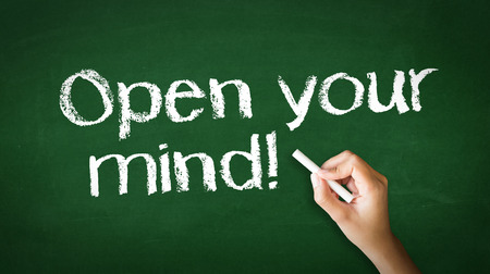 A person drawing and pointing at a Open Your Mind Chalk Illustration