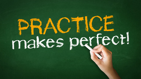 A person drawing and pointing at a Practice Makes Perfect Chalk Illustration