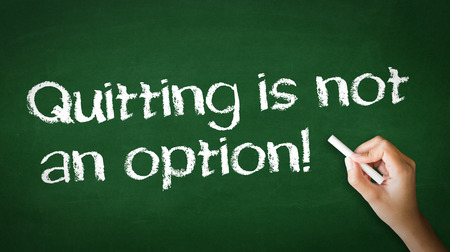 A person drawing and pointing at a Quitting is not an Option Chalk Illustration
