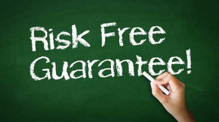 A person drawing and pointing at a Risk Free Guarantee Chalk Illustration Фото со стока - 25604335