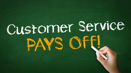 pays: A person drawing and pointing at a Customer service pays off Chalk Illustration