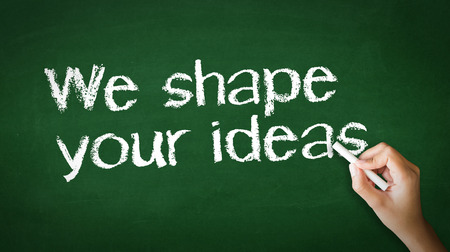 A person drawing and pointing at a We Shape Your Ideas Chalk Illustration Фото со стока - 25604337