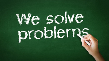 A person drawing and pointing at a We Solve Problems Chalk Illustration Stockfoto