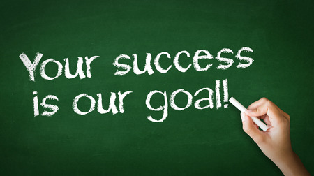 A person drawing and pointing at a Your Success is our goal Chalk Illustration Standard-Bild
