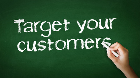 defining: A person drawing and pointing at a Target Your Customers Chalk Illustration