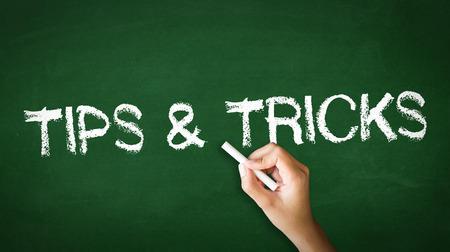 A person drawing and pointing at a Tips and Tricks Chalk Illustration