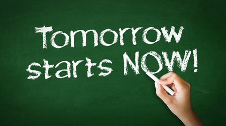 A person drawing and pointing at a Tomorrow starts Now Chalk Illustration Stockfoto