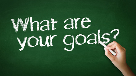 A person drawing and pointing at a What Are your Goals Chalk Illustration Фото со стока - 25604396