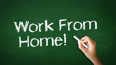 A person drawing and pointing at a Work From Home Chalk Illustration