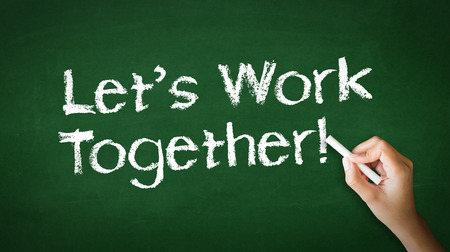 lets: A person drawing and pointing at a Lets work together Chalk Illustration  Stock Photo