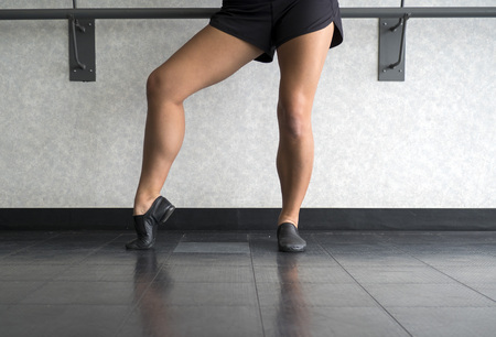 Posing in Jazz shoes at the barre in dance class