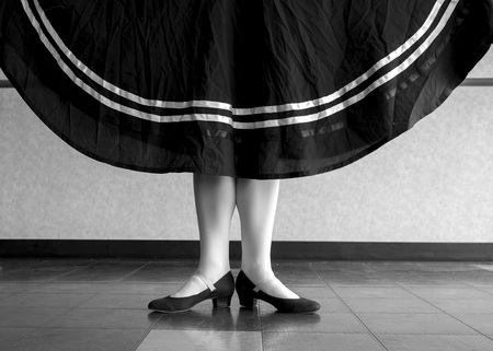 Black and white Character Ballet dancer in first position holding her skirt