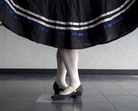 Character Ballet, fifth position with skirt held