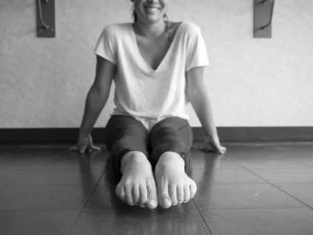 Black and White version of Dancer's pointed bare feet in the dance studio