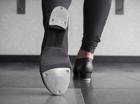 Toe Tap in Tap shoes with a back view