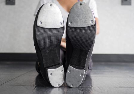 Bottom of my tap shoes making rhythms Reklamní fotografie