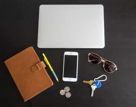 Business office workspace with Various items isolated on a black desk background