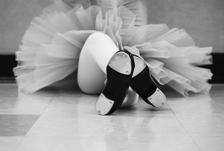 Black and white version of Little girl wearing a tutu and tap shoes in her tap dance class