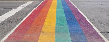 Pride Rainbow Sidewalk Crosswalk in downtown Stock Photo
