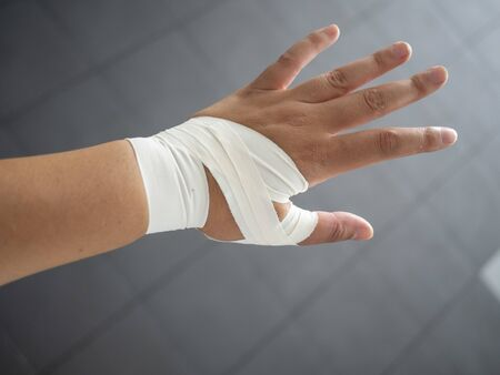 Athlete with a taped thumb