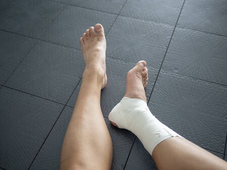 Athlete staring at her injured ankle