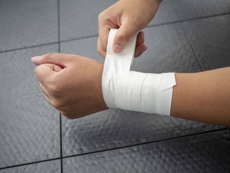 Athlete taping her own wrist