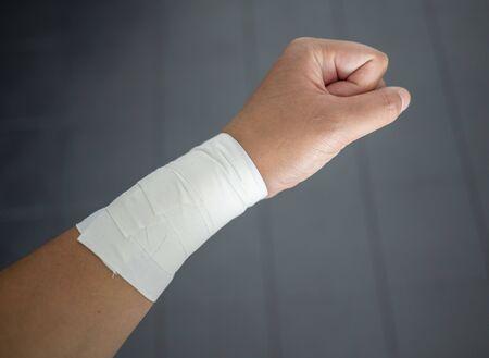 Making a fist with a wrist tape job