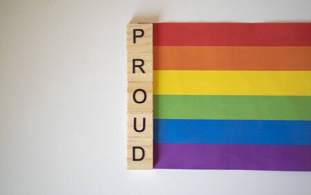 Proud with Pride LGBTQ+ rainbow flag on a white background