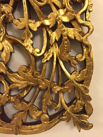 gold leaf: Gold leaf carved wood accent