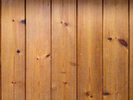 Pine walls wooden panel are a background texture vertical aligned. Фото со стока