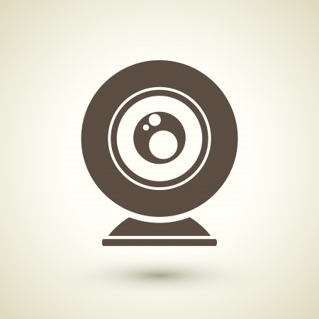 web cam: retro style web camera icon isolated on brown background Illustration