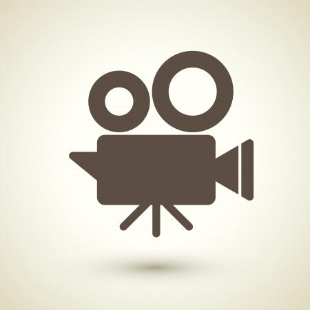 stile retrò icona della fotocamera cinema isolato su marrone Vettoriali