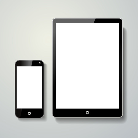 blank mobile phone and touch pad isolated over grey background