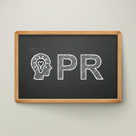 PR on blackboard in wooden frame isolated over grey