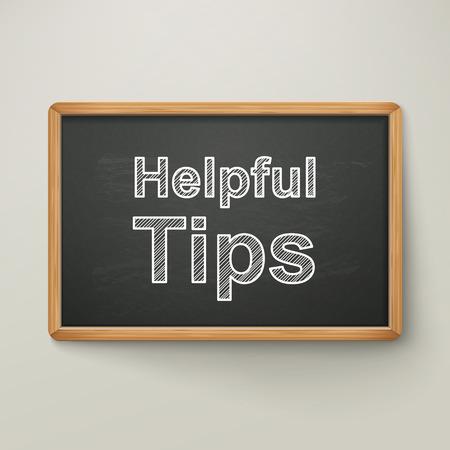 helpful: helpful tips on blackboard in wooden frame  isolated over grey