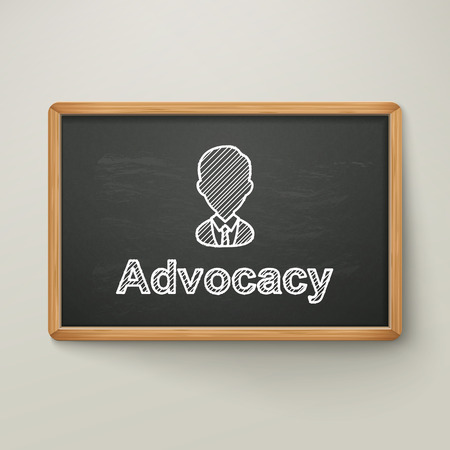 advocacy: advocacy on blackboard in wooden frame isolated over grey
