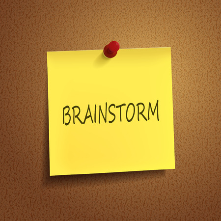 post it note: brainstorm word on post-it over brown background