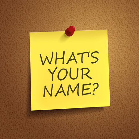 what is your name words on post-it over brown background