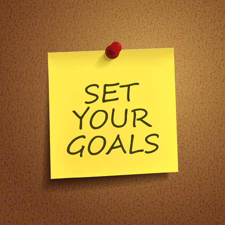 set goals: set your goals words on post-it over brown background
