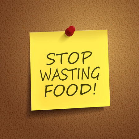 wasting: stop wasting food words on post-it over brown background