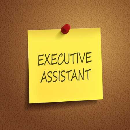 executive assistant words on post-it over brown background