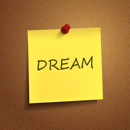 fantasize: dream word on post-it over brown background