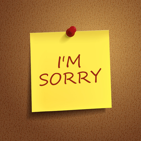 i am sorry: I am sorry words on post-it over brown background