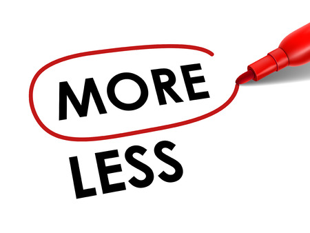 less: choosing more instead of less with a red pen over white paper