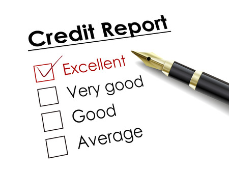 credit score: tick placed in excellent check box with fountain pen over credit report