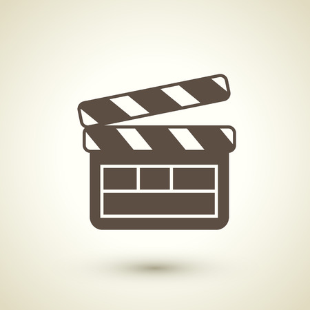 clapperboard: retro flat design icon with  clapperboard element over brown background